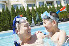 Father and son with snorkeling equipment in the pool Stock Photo