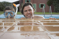 Father With Son In Snorkeling Mask At Pool Stock Photography