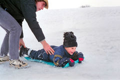 Father and Son Snow Sledding, Ontario Canada. Father and son enjoy the winter together stock photography