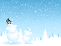 Father and son snowmen. Happy father and son snowmen on snowy background Royalty Free Stock Photo