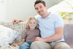 Father and son on sofa Stock Photo