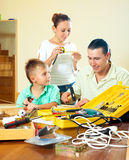 Father and son spend their free time with working tools at home Royalty Free Stock Image