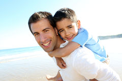 Father and son spending good time together on the beach Royalty Free Stock Photos