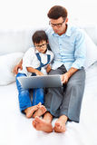Father and son spending  leisure time Stock Images