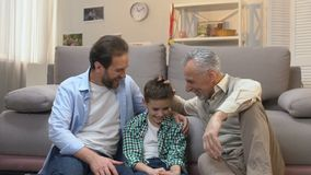 Father and son spending pastime, enjoying visit to grandfather, slow-motion. Stock footage stock video footage