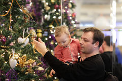 Father with son spending time by Christmas tree Stock Photo