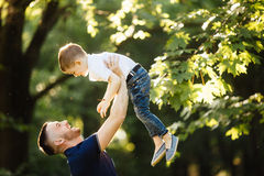 Father and son spending time outside Royalty Free Stock Photo