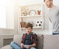 Father and son spending time together at home stock photo