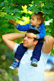 Father and son spending time together outdoors Royalty Free Stock Images