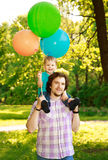 Father and son spending time together on a sunny day. Happy litt Royalty Free Stock Photography