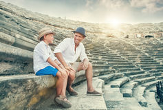 Father and son spent time together on antique ruins amphitheater Stock Image
