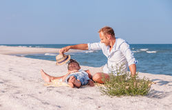 Father with son spent time together on the sea sand beach in sun Royalty Free Stock Images