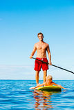 Father and Son Stand Up Paddling Stock Photos