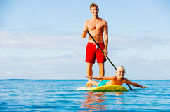 Father and Son Stand Up Paddling Stock Image