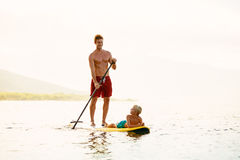 Father and Son Stand Up Paddling Royalty Free Stock Image
