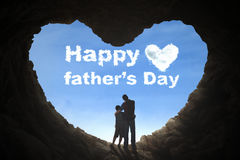 Father and son standing in cave Royalty Free Stock Image