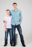 Father and son are standing in an embrace. In jeans and shirts stock photo