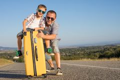 Father and son standing in the park at the day time. Stock Photos