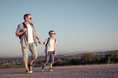Father and son standing in the park at the day time. Royalty Free Stock Image