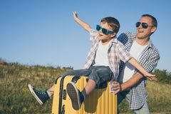Father and son standing in the park at the day time. Royalty Free Stock Photography