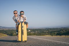 Father and son standing in the park at the day time. Stock Image