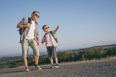 Father and son standing in the park at the day time. Stock Images