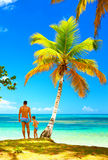 Father and son standing on tropical island beach Royalty Free Stock Image