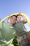 Father and Son Standing Under Pole - Vertical Royalty Free Stock Image
