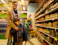 Father and son in a store Royalty Free Stock Image