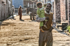 Father and son on the street. Kids in the vilage near Patiala , Punjab India Stock Photo