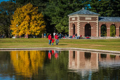 Father and Son Stroll in Saratoga State Park. Family walk in the park past fall reflection on pool Royalty Free Stock Photos