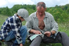 Father and son studying the map Royalty Free Stock Image