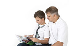 Father and son are studying together Stock Photography