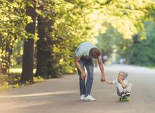 Father and son in summer stock photos