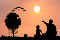 Father and son sunset background Royalty Free Stock Image