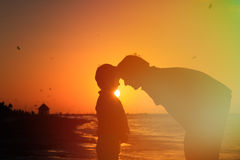 Father and son at sunset beach. Family concept Stock Photo