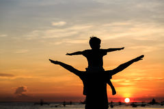 Father and son on sunset beach Royalty Free Stock Photography