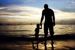 Father and son on sunset sea background Royalty Free Stock Photography
