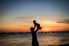 Father and son at sunset sea Royalty Free Stock Photos