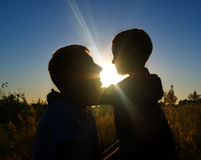 Father and son at sunset Royalty Free Stock Photography