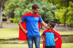 Father and son in superhero costume Stock Images