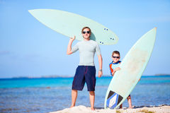 Father and son with surfboards royalty free stock photos