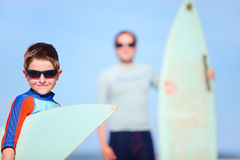 Father and son with surfboards Stock Image