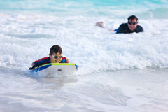 Father and son surfing. On boogie boards Stock Photography