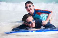Father and son surfing Royalty Free Stock Photo