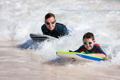 Father and son surfing Royalty Free Stock Photography