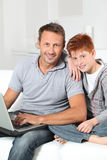 Father and son surfing on internet Royalty Free Stock Photography