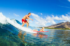 Father and Son Surfing, Riding Wave Together Stock Photography