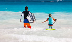 Father and son surfing Stock Image