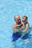 Father and Son in Swimming Pool Royalty Free Stock Image